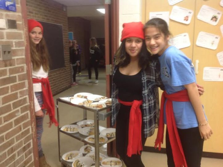 Young ladies wearing the ceinture flechee and tuque for Mrs. Potier's French Canadian heritage celebration.