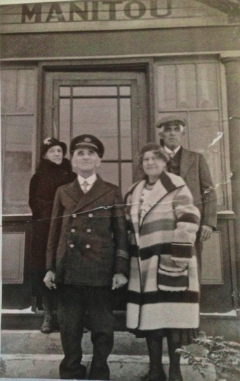 The Captain and Jane (in front), and Louis' brother Isaac Goudreau and his wife Mary Jane Therrien Goudreau, on the steps of their new home Manitou on Spring Street in St. Ignace, Michigan.