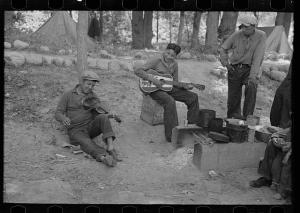 Indian boys playing guitar and violin in blueberry camp near Little Fork, Minnesota. Russell Lee, Photographer, 1937. Library of Congress #fsa1997021801/PP